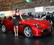 hot babe standing nearby an alfa romeo 8c competizione - front view