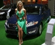 hot sexy babe posing in front of a ford presenting the econetic concept