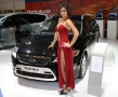 beatiful girl standing next to a ford mondeo titanium