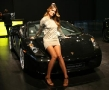 hot babe posing on a gallardo spyder