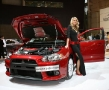 babe next to a mitsubishi lancer evolution