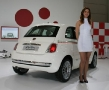 babe next to the new fiat 500