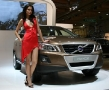 volvo xc60 with a hot babe posing next to it
