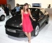 hot girl next to the new vw (volkswagen) scirocco