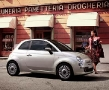 Girl next to the New Fiat 500