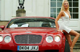 Hot Blonde next to a Bentley
