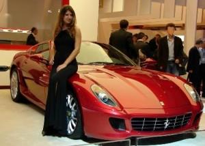 Sexy Babe Standing next to a Ferrari
