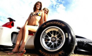 2 Beautiful GirlsSitting on a Formula 1 Car