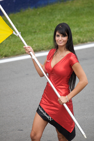 Formula 1 Sexy Babe in Red Holding a Yellow Flag