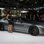 Car Babe standing next to a Lamorghini Estoque - Paris Auto Show