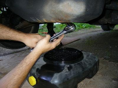 Man changing his car oil