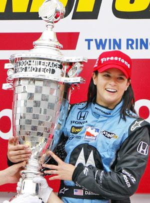Danica Patrick holding a Wining Trophy