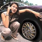 Women on phone asking for help on a flat tire